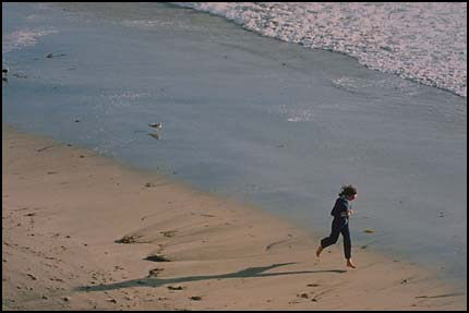 Figure running on beach