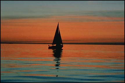 Sailboat on water-horizon middle